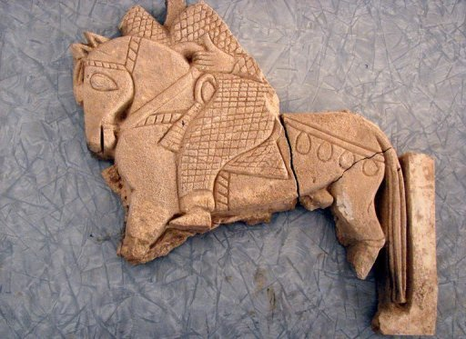 A sculpture of a knight riding a horse which dates back to the Ummayad period